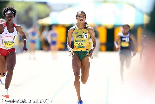 FARGO, ND - MAY 13: Alexis Woods from North Dakota State University sprints to the finish line during the women's 4x100 meter relay Saturday at the 2017 Summit League Outdoor Track Championship at the Ellig Sports Complex in Fargo, ND. (Photo by Dave Eggen/Inertia)