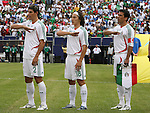 10 June 2007: Mexico's Jose Jonny Magallon (2), Jose Andres Guardado (18), and Pavel Pardo (r) during the playing of the Mexican national anthem. The Honduras Men's National Team defeated the National Team of Mexico 2-1 at Giants Stadium in East Rutherford, New Jersey in a first round game in the 2007 CONCACAF Gold Cup.