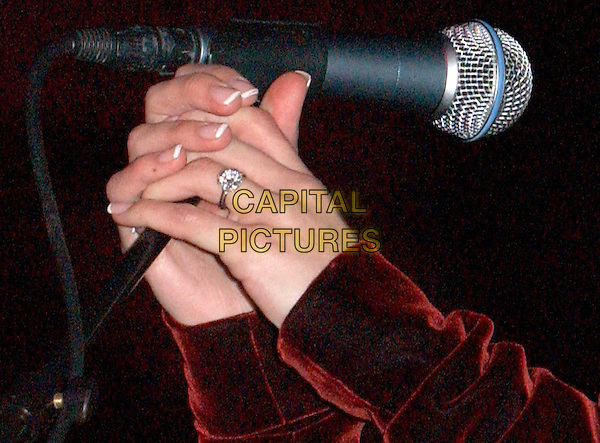 BRITTANY MURPHY.Rock for Choice Benefit Concert held at The Hollywood Palladium in Hollywood, California .23 January 2004       .*UK Sales Only*                                           .engagement ring, hands, manicured nails                             .www.capitalpictures.com.sales@capitalpictures.com.©Capital Pictures.
