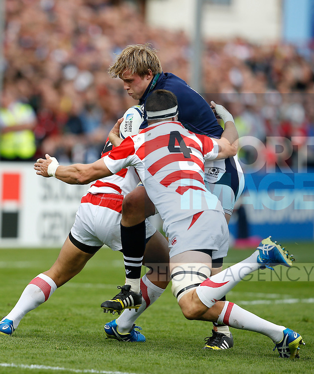 Jonny Gray of Scotland tackled by Luke Thompson of Japan - Rugby World Cup 2015 - Pool B - Scotland vs Japan - Kingsholm Stadium - Gloucester - England - 23rd September 2015 - Picture Simon Bellis/Sportimage