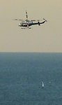A Chicago Fire Department helicopter flies over Lake Michigan and the Ohio Street Beach in Chicago, July 18, 2016. (DePaul University/Jamie Moncrief)