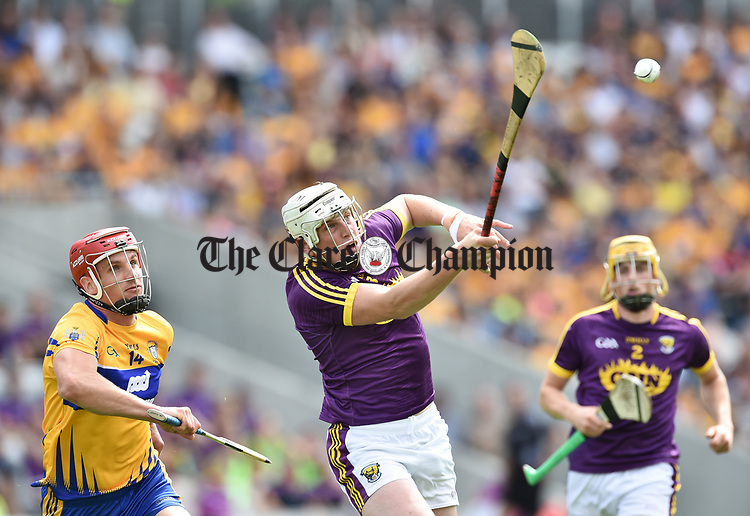 John Conlon of Clare in action against Liam Ryan of Wexford during their All-Ireland quarter final at Pairc Ui Chaoimh. Photograph by John Kelly.