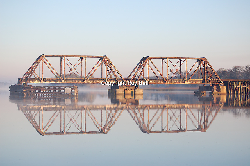Old Railroad bridge on the intercoastal waterway near Appalatchacola Florida in the early morning