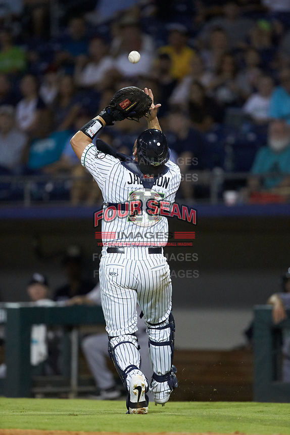 Gwinnett Stripers catcher Alex Jackson (25) catches a foul pop fly during the game against the Scranton/Wilkes-Barre RailRiders at BB&T BallPark on August 17, 2019 in Lawrenceville, Georgia. The Stripers defeated the RailRiders 8-7 in eleven innings. (Brian Westerholt/Four Seam Images)