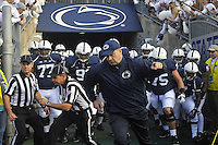 12 October 2013:  Penn State coach Bill O'Brien leads the team out the tunnel and onto the field before the game. The Penn State Nittany Lions defeated the Michigan Wolverines 43-40 in 4OTs at Beaver Stadium in State College, PA.