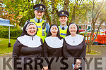 Nuns gathering in an attempt to break the Guinness World Record in the Tralee Town Park's fundriaser fot the Tralee rowing Club and Pieta House on Saturday. Margaret Wharton (Tralee), Josie O'Shea (Ballymac), Gemma O'Shea (Tralee) stand with Gda Alan Clerkin and Gda Tom Moynihan