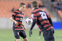 Houston, TX - Friday December 9, 2016: Jared Gilbey (15) of the Stanford Cardinal gains control of a loose ball against North Carolina Tar Heels at the NCAA Men's Soccer Semifinals at BBVA Compass Stadium in Houston Texas.