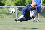 Kasey Keller makes a diving save on Saturday, May 20th, 2006 at SAS Soccer Park in Cary, North Carolina. The United States Men's National Soccer Team held a training session as part of their preparations for the upcoming 2006 FIFA World Cup Finals being held in Germany.