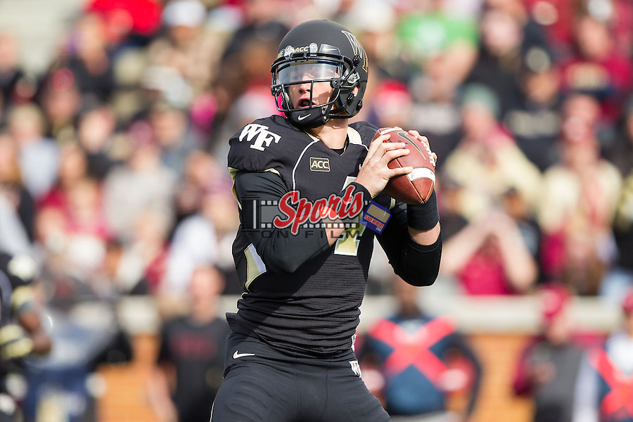 Tyler Cameron (4) of the Wake Forest Demon Deacons drops back to pass during first half action against the Florida State Seminoles at BB&T Field on November 9, 2013 in Winston-Salem, North Carolina.  The Seminoles defeated the Demon Deacons 59-3.    (Brian Westerholt/Sports On Film)