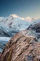 Soft pastel dawn over Tasman Glacier as seen from Ball Ridge with De la Beche 2950m in background and climber giving sense of scale at end of ridge, Aoraki Mt. Cook National Park, UNESCO World Heritage, Mackenzie Country, South Island, New Zealand, NZ