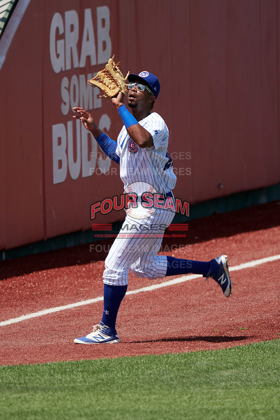 South Bend Cubs left fielder Eloy Jimenez (27) catches a fly ball during the first game of a doubleheader against the Peoria Chiefs on July 25, 2016 at Four Winds Field in South Bend, Indiana.  South Bend defeated Peoria 9-8.  (Mike Janes/Four Seam Images)