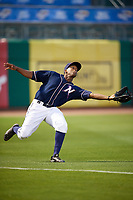 Northwest Arkansas Naturals left fielder Elier Hernandez (21) reaches out to try to catch a fly ball during a game against the Midland RockHounds on May 27, 2017 at Arvest Ballpark in Springdale, Arkansas.  NW Arkansas defeated Midland 3-2.  (Mike Janes/Four Seam Images)