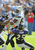 Sep. 20, 2009; San Diego, CA, USA; San Diego Chargers wide receiver (85) Antonio Gates is tackled by Baltimore Ravens cornerback (25) Chris Carr at Qualcomm Stadium in San Diego. Baltimore defeated San Diego 31-26. Mandatory Credit: Mark J. Rebilas-