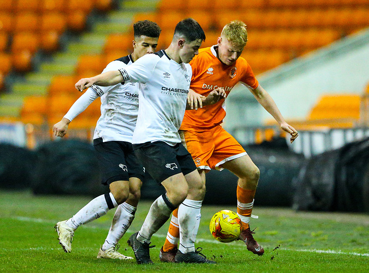 Blackpool's Owen Watkinson battles with Derby County's Eiran Cashin and Kornell McDonald<br /> <br /> Photographer Alex Dodd/CameraSport<br /> <br /> The FA Youth Cup Third Round - Blackpool U18 v Derby County U18 - Tuesday 4th December 2018 - Bloomfield Road - Blackpool<br />  <br /> World Copyright © 2018 CameraSport. All rights reserved. 43 Linden Ave. Countesthorpe. Leicester. England. LE8 5PG - Tel: +44 (0) 116 277 4147 - admin@camerasport.com - www.camerasport.com