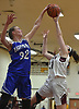 Lauren Romito #32 of Hauppauge, left, blocks a shot during a non-league tournament game against host Whitman High School on Friday, Nov. 30, 2018.