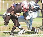 The Gazette Suitland running back Dontrewell Kelley does some hard running as Eleanor Roosevelt defender Osasu Osagie tries to bring him down during the forth quarter of Roosevelt's 21-2 win over Suitland High School at Suitland on Saturday afternoon.