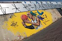 """SÃO PAULO,SP,12.07.2015 - ARTE-SP - Desenho em homenagem ao jogador brasileiro de basquete Leandrinho que atua na liga norte-americana """"NBA""""é visto na parede da estação Pirituba da CPTM na região oeste de São Paulo neste domingo,12. Leandrinho passou sua infância e cresceu no bairro antes de se tornar jogador.( Foto Marcio Ribeiro / Brazil Photo Press)"""