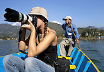 Deddeda takes photos from a boat on Phewa Tal lake in Pokhara, Nepal.