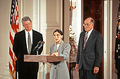 Associate Justice of the Supreme Court Ruth Bader Ginsburg, center, makes remarks prior to taking the oath of office during a swearing-in ceremony in the East Room of the White House in Washington, DC on August 10, 1993. Looking on are United States President Bill Clinton, left, and Chief Justice of the United States William H. Rehnquist, right.  Justice Ginsburg replaces Associate Justice Byron R. White.<br /> Credit: Arnie Sachs / CNP