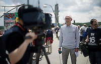 Sporza commentator Michel Wuyts getting ready for a live intervention in the 1pm news<br /> <br /> Belgian National Road Cycling Championships 2016<br /> Les Lacs de l'Eau d'Heure