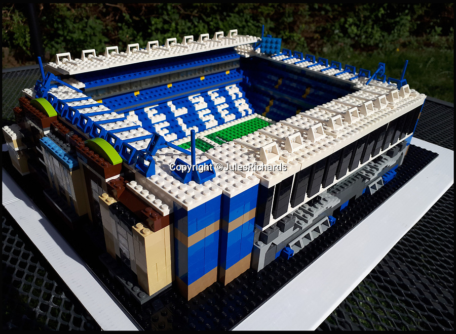BNPS.co.uk (01202 558833)<br /> Pic: JulesRichards/BNPS<br /> <br /> Chelsea's Stamford Bridge.<br /> <br /> Here lego, here lego, here lego.....<br /> <br /> A supermarket manager is building all 92 Football League grounds out of Lego.<br /> <br /> Jules Richards built his first stadium out of Lego he found in his loft one afternoon 18 months ago and he is now over two thirds of the way to completing all 92 Premier League, Championship, League One and League Two grounds.<br /> <br /> The 44 year-old spends up to 12 hours on each stadium and uses on average 1,300 Lego blocks to make them look uncannily similar to the real thing.