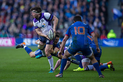 11th February  2018, Murrayfield Stadium, Edinburgh, Scotland; NatWest Six Nations Rugby, Scotland versus France; Hamish Watson of Scotland is tackled by Maxime Machenaud of France