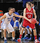 SIOUX FALLS, SD - MARCH 5:  Casey Kasperbauer #14 of South Dakota looks to pass against defender Max Landis #10 of Fort Wayne in the 2016 Summit League Tournament.  (Photo by Dick Carlson/Inertia)