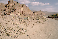 The destroy Bamiyan Bazaar in 1999. .The heavy fight between the local Hazara Moslem Shiia how defend them self and the Taleban Moslem Sunni destroy 60% of the Bamiyan city. On the left cliff, the niche of the 54 meters statue of Buddha and on the right, the niche of the 34meters, decapitate statue of Buddha. (See the former picture in 1995 of the same Bazaar)