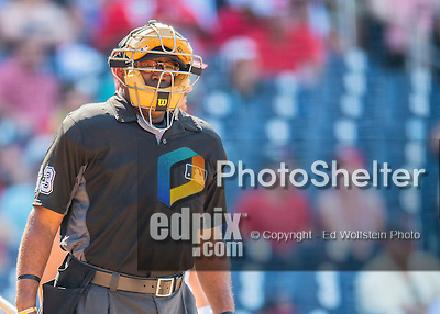 24 July 2016: MLB Umpire Laz Diaz works home plate during a game between the San Diego Padres and the Washington Nationals at Nationals Park in Washington, DC. The Padres defeated the Nationals 10-6 to take the rubber match of their 3-game, weekend series. Mandatory Credit: Ed Wolfstein Photo *** RAW (NEF) Image File Available ***