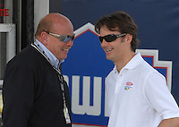 Apr 27, 2007; Talladega, AL, USA; Nascar Nextel Cup Series driver Jeff Gordon (24) talks with official John Darby during practice for the Aarons 499 at Talladega Superspeedway. Mandatory Credit: Mark J. Rebilas