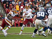 Washington Redskins quarterback Alex Smith (11) hands-off to running back Adrian Peterson (26) in first quarter action against the Dallas Cowboys at FedEx Field in Landover, Maryland on Sunday, October 21, 2018.  Defending on the play are Dallas Cowboys linebacker Sean Lee (50) and nose tackle Antwaun Woods (99).<br /> Credit: Ron Sachs / CNP