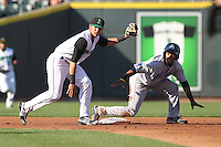 Lake County Captains shortstop Francisco Lindor #12 steals second base as Dayton Dragons shortstop Juan Perez #11 applies a late tag during a game at Fifth Third Field on June 25, 2012 in Dayton, Ohio. Lake County defeated Dayton 8-3. (Brace Hemmelgarn/Four Seam Images)