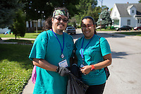 "Ryan Ocampo, left, and Natalie Henriquez pose for a photo as they pick up trash in the Hawthorne neighborhood during ""Circle the City with Service,"" the Kiwanis Circle K International's 2015 Large Scale Service Project, on Wednesday, June 24, 2015, in Indianapolis. (Photo by James Brosher)"