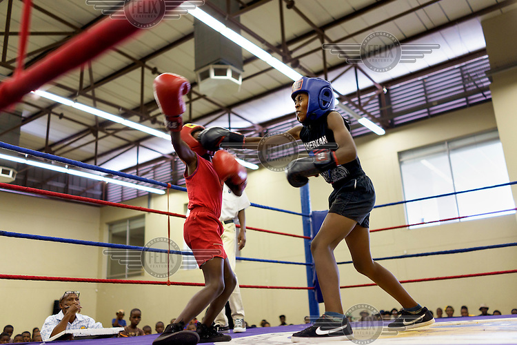 Young boxers spar during an amateur boxing tournament in Cosmo City, a large low-income housing development 25 kms north of Johannesburg, South Africa.
