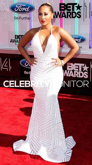 LOS ANGELES, CA, USA - JUNE 29: Singer Adrienne Bailon arrives at the 2014 BET Awards held at Nokia Theatre L.A. Live on June 29, 2014 in Los Angeles, California, United States. (Photo by Xavier Collin/Celebrity Monitor)