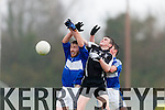 Seanie O'Shea PS Inbhear Sceine punches the ball away from Conchur O Mhurchu Ballyvourney during the Corn Sheain Ui Mhurchu final in Killarney on Saturday