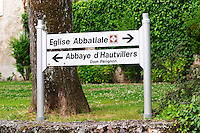Signs pointing to the Abbey monastery church where Dom Perignon lies (open to visitors) and to the Abbey monastery where Dom Perignon worked, now the property of Louis Vuitton Moet Hennessy (Moet & Chandon) (open only to invited guests), the village of Hautvillers in Vallee de la Marne, Champagne, Marne, Ardennes, France