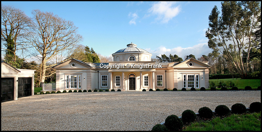 BNPS.co.uk (01202 558833)<br /> Pic: KnightFrank/BNPS<br /> <br /> Bolthole-in-one!<br /> <br /> Golf fans will be green with envy - This brand new Palladian style pad comes with a fantastic view of the 17th green at exclusive Wentworth golf club in Surrey.<br /> <br /> But despite the &pound;6.75 million price tag you will still have to pass muster with the members and stump up a &pound;125,000 joining fee to become part of the world famous club.<br /> <br /> Greenside is part of the Wentworth Estate, one of the most expensive private estates in the country, which has the Wentworth Golf Club at its heart.<br /> <br /> The lucky buyer of this house can watch the world's best golfers battle it out for the European Tour's PGA Championship from the balcony overlooking the 17th green of the iconic West Course.<br /> <br /> The newly-built five-bedroom home, on the market with Knight Frank, has everything you could need, including an indoor swimming pool complex with a sauna and a spa.