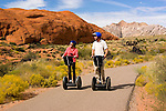 Couple of a Segway at Snow Canyon State Park, Utah, UT, scenic, landscape, Segways, Segway riders, model released, rock formations, landforms, Navajo sandstone, arid, Southwest America, American Southwest, US, United States, Image ut416-18823, Photo copyright: Lee Foster, www.fostertravel.com, lee@fostertravel.com, 510-549-2202