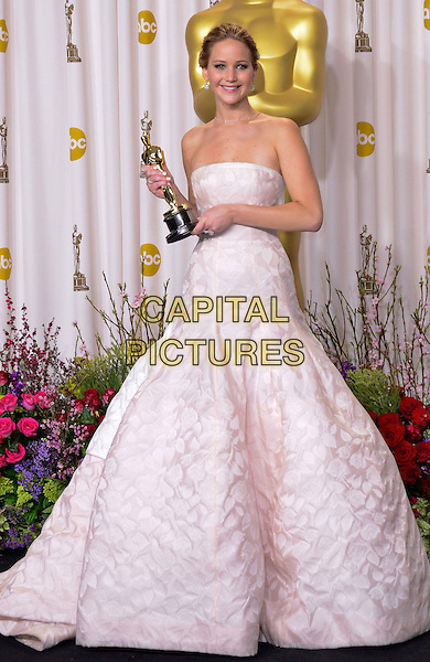Jennifer Lawrence (wearing Dior Haute Couture).85th Annual Academy Awards held at the Dolby Theatre at Hollywood & Highland Center, Hollywood, California, USA..February 24th, 2013.pressroom oscars full length white pale pink strapless dress gown voluminous award trophy winner.CAP/ADM/RE.©Russ Elliot/AdMedia/Capital Pictures.