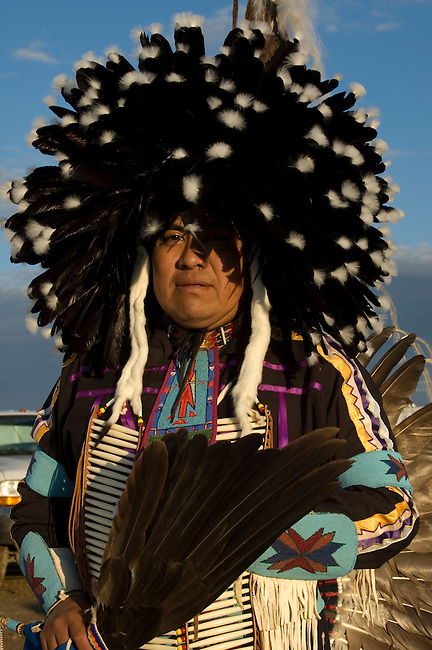 Mandan man dressed in traditional regalia and specific round shaped feather headdress of the Mandan Indians during the Sacajawea Celebration on the Fort Berthold Indian Reservation, ND