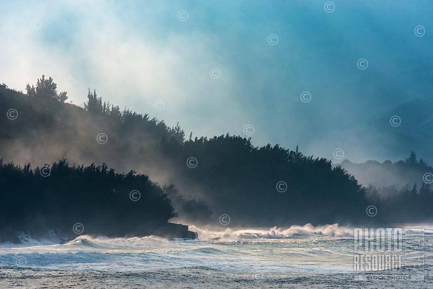 Dramatic light through heavy sea spray (or ehu kai) at Lumahai Beach on the northern shore of Kaua'i.