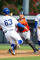 Greeneville Astros catcher Jacob Nottingham (27) waits to apply the tag to Ryan Dale (63) of the Burlington Royals as he tries to score a run at Burlington Athletic Park on June 29, 2014 in Burlington, North Carolina.  The Royals defeated the Astros 11-0. (Brian Westerholt/Four Seam Images)