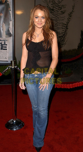 LINDSAY LOHAN.The World Premiere of The Perfect Score held at The Cinerama Dome in Hollywood, California .27 January 2004                                                   .*UK Sales Only*.full length, full-length, denim jeans, black vest top.www.capitalpictures.com.sales@capitalpictures.com.©Capital Pictures.