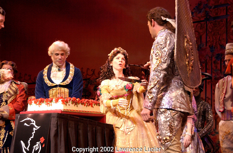 Actress Sarah Litzsinger (Belle) asks ensemble player Christopher Monteleone (Cake Server) to cut the cake celebrating the 3225th performance of Disney's Beauty and the Beast March 13, 2002, in New York. Beauty and the Beast joins the list of Broadway's top ten longest running shows today..