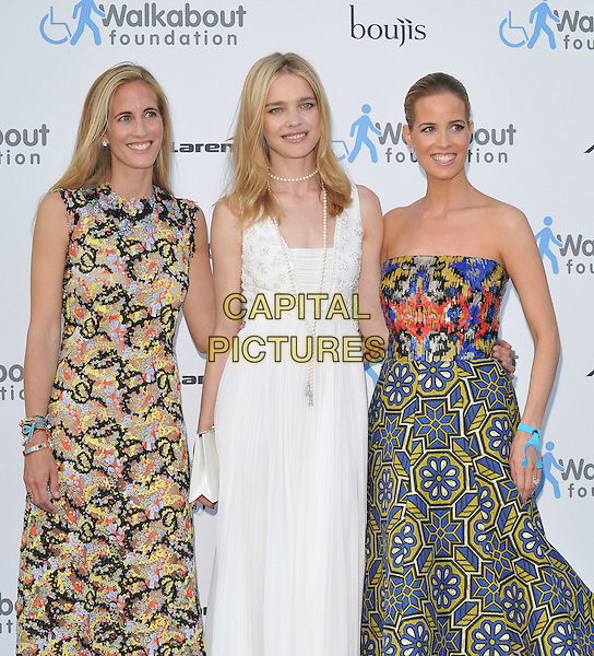 LONDON, ENGLAND - JUNE 27: Adriana Chryssicopoulos, Natalia Vodianova &amp; Carolina Gonzalez Bunster attend the Walkabout Foundation's Inaugural Gala, Natural History Museum, Cromwell Rd., on Saturday June 27, 2015 in London, England, UK. <br /> CAP/CAN<br /> &copy;Can Nguyen/Capital Pictures