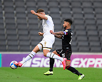 Lincoln City's Liam Bridcutt battles with Milton Keynes Dons' Carlton Morris<br /> <br /> Photographer Chris Vaughan/CameraSport<br /> <br /> The EFL Sky Bet League One - Milton Keynes Dons v Lincoln City - Saturday 19th September 2020 - Stadium MK - Milton Keynes<br /> <br /> World Copyright © 2020 CameraSport. All rights reserved. 43 Linden Ave. Countesthorpe. Leicester. England. LE8 5PG - Tel: +44 (0) 116 277 4147 - admin@camerasport.com - www.camerasport.com