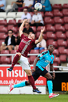 Fleetwood Town's Amari'i Bell competing with Northampton Town's Aaron Phillips <br /> <br /> Photographer Andrew Kearns/CameraSport<br /> <br /> The EFL Sky Bet League One - Northampton Town v Fleetwood Town - Saturday August 12th 2017 - Sixfields Stadium - Northampton<br /> <br /> World Copyright &copy; 2017 CameraSport. All rights reserved. 43 Linden Ave. Countesthorpe. Leicester. England. LE8 5PG - Tel: +44 (0) 116 277 4147 - admin@camerasport.com - www.camerasport.com