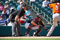 Home plate umpire Jonathan Bailey and Rochester Red Wings catcher Eric Fryer (22) during a game against the Norfolk Tides on May 3, 2015 at Frontier Field in Rochester, New York.  Rochester defeated Norfolk 7-3.  (Mike Janes/Four Seam Images)