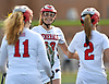 Erin Vaughan Ware #28 of MacArthur, center, celebrates with teammates Angeline Klein #11, left, and Katelyn Politi #2 after Politi scored a goal in the first half of a Nassau County varsity girls lacrosse game against Mepham at MacArthur High School on Monday, March 20, 2017. Vaughan Ware tallied three goals and four assists. Her final goal drew her within one of the school's career record of 147 held by Candace Noakes. She will have the opportunity to break that record during the Lady Generals' next game, which is scheduled for Saturday, March 25 10:00AM against Clarke at MacArthur High School.